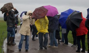 Stonehenge tourists braving the driving rain